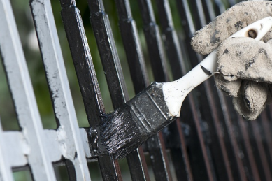 repainting-old-iron-fence-that-is-worn-down-and-rusted-due-to-weather